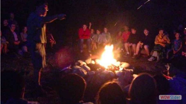 Singing round the camp fire at Camp Byng