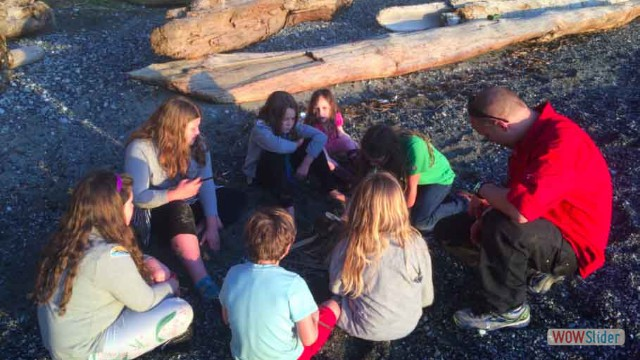 Learning fire making skills at Pebbly Beach